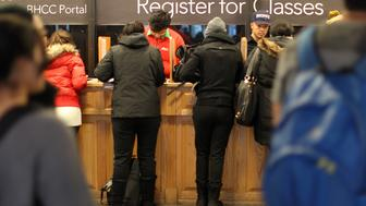 BOSTON - JANUARY 20: Students register for classes at Bunker Hill Community College and are asked about President Obama's plans for free tuition to community colleges. (Photo by Suzanne Kreiter/The Boston Globe via Getty Images)