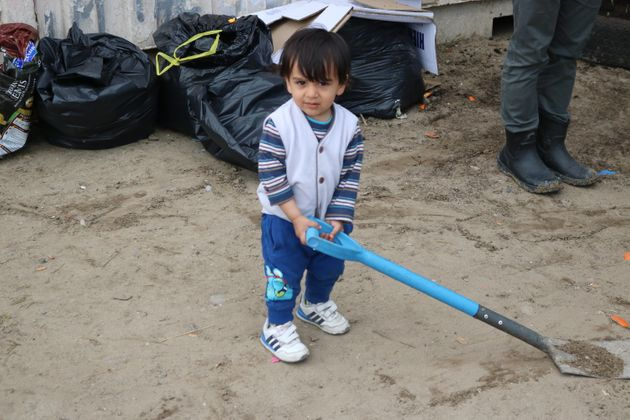 A two-year-old Afghan boy plays outside the women and children's