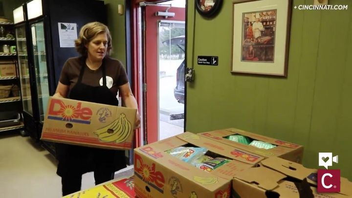 Chef Suzy DeYoung carrying in a box of donations.