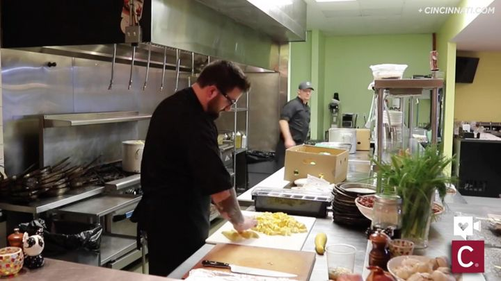 Volunteer chefs prep produce for soup.