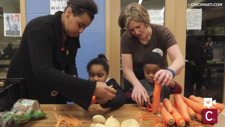 DeYoung teaches kids how to peel vegetables in one of her classes.