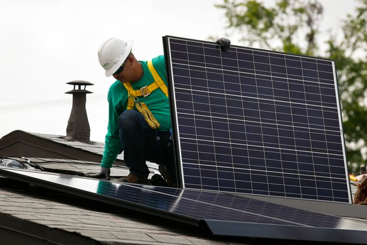A solar panel is installed on the roof of a home in Los Angeles in 2014. More solar energywill be coming to San Francis
