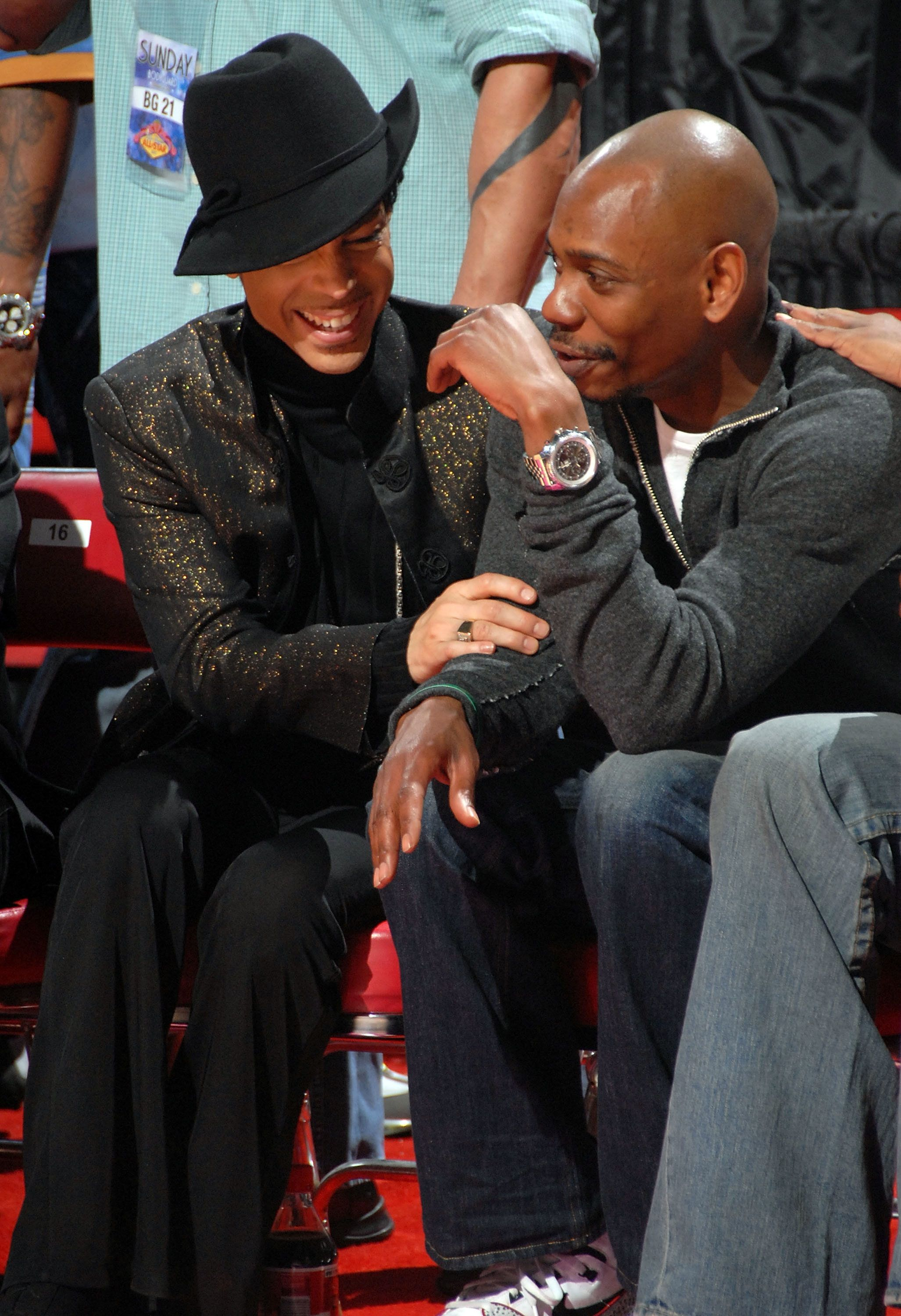 LAS VEGAS - FEBRUARY 18:  Prince sits courtside and talks with comedian Dave Chappelle at the 2007 NBA All-Star Game on February 18, 2007 at Thomas & Mack Center in Las Vegas, Nevada. NOTE TO USER: User expressly acknowledges and agrees that, by downloading and or using this photograph, User is consenting to the terms and conditions of the Getty Images License Agreement. Mandatory Copyright Notice: Copyright 2007 NBAE  (Photo by Andrew D. Bernstein/NBAE via Getty Images)