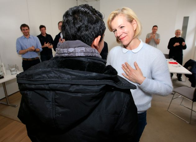 Actress Juliet Stevenson (pictured with a Syrian refugee in London) bought Clegg the double decker bus...
