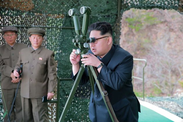 Kim Jong Un guides on the spot the underwater test-fire of strategic submarine ballistic missile in this...