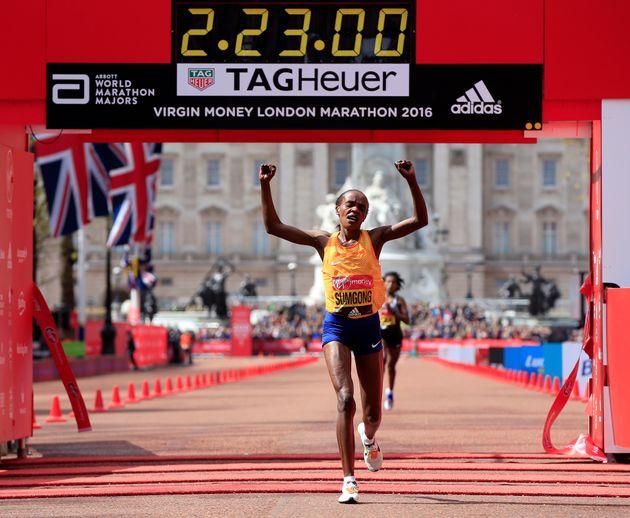 Kenya's Jemima Sumgong crosses the line to win the Elite Women's Race during the 2016 Virgin Money London