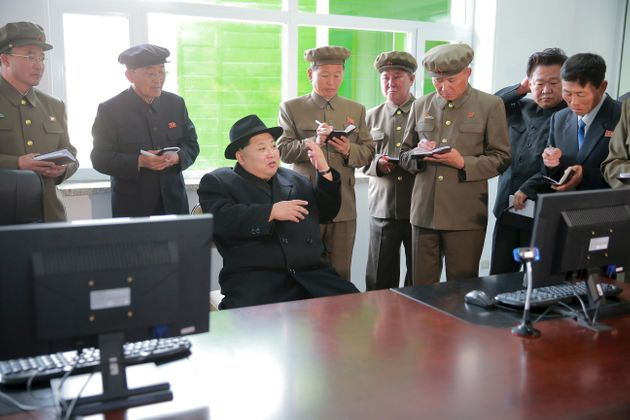North Korean leader Kim Jong Un visits the Paektusan Hero Youth Power Station No. 3 in this undated photo...