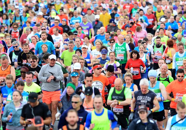 Runners make their way over the start line during the 2016 Virgin Money London
