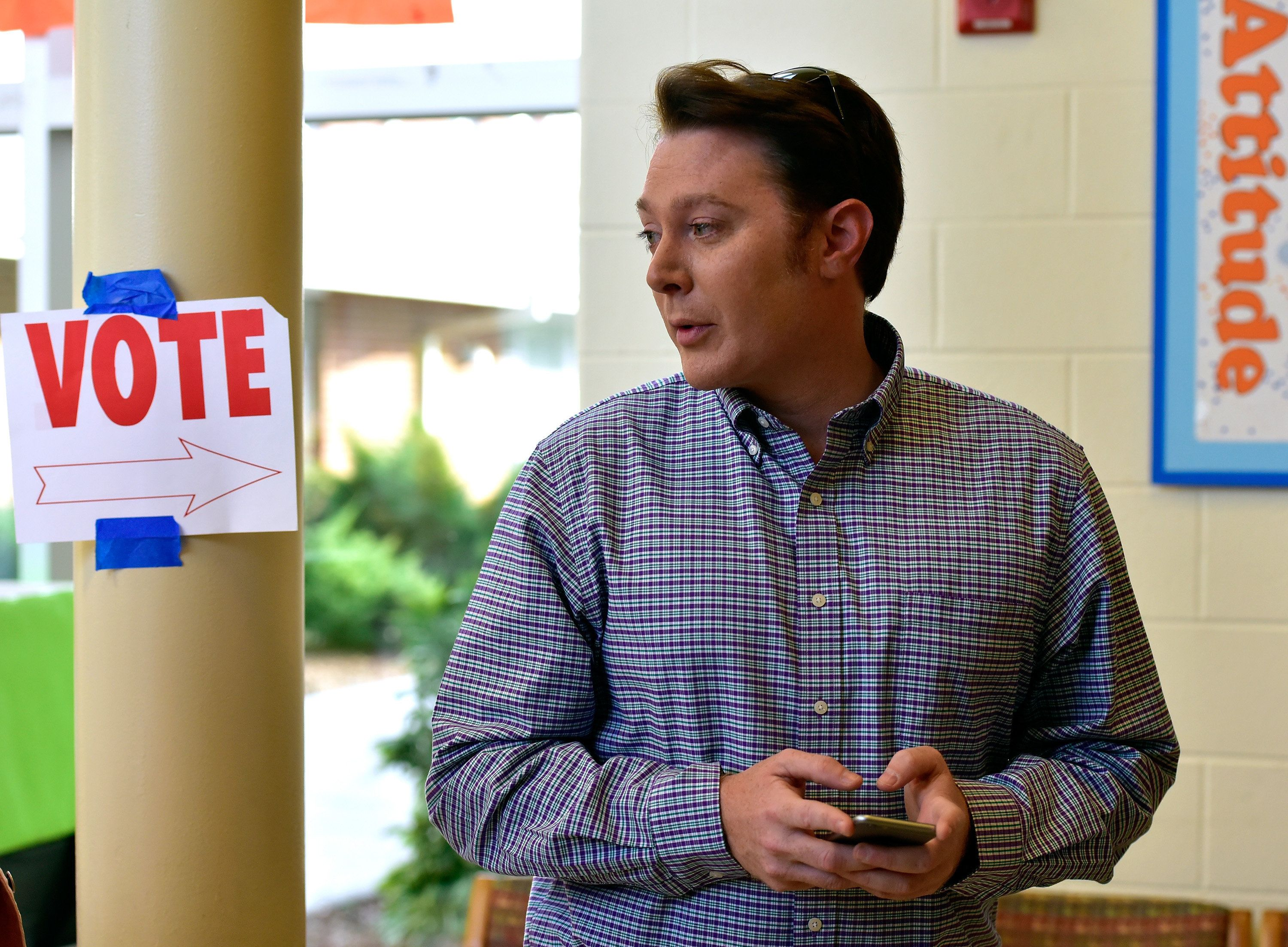 CARY, NC - NOVEMBER 04:  Clay Aiken, Democratic candidate for U.S. Congress in North Carolina's Second District, waits in line to vote in the midterm elections on November 4, 2014 at Mills Park Elementary School in Cary, North Carolina. Aiken, a former 'American Idol' contestant, is running for political office for the first time.  (Photo by Grant Halverson/Getty Images)