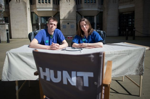 Junior doctors Rachel Clarke from Oxford and Dagan Lonsdale from Londonsatoutside the Department...