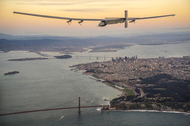 Solar Impulse 2 flies over the Golden Gate Bridge in San Francisco before completing its flight across...