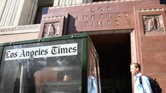 Los Angeles, UNITED STATES: The 'Los Angeles Times' newspaper building in downtown Los Angeles,24 April 2007. The Los Angeles Times will offer buyouts to up to 150 employees to offset declining circulation and advertising in the latest effort by parent company Tribune Co. to cut jobs ahead of its plan to go private in an 8.2 billion USD deal. The buyouts would equal three percent to five percent of workers at the Times, Tribune's largest newspaper, publisher David Hiller wrote in a note to the staff.    AFP PHOTO/GABRIEL BOUYS (Photo credit should read GABRIEL BOUYS/AFP/Getty Images)