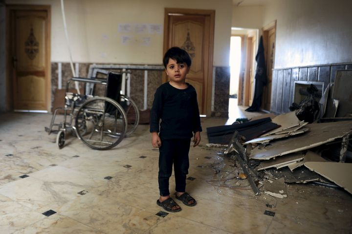 A boy, who was evacuated with others from two rebel-besieged towns of Foua and Kefraya in the northwestern province of Idlib,