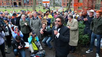 CAMBRIDGE, MA - APRIL 17: Cornel West speaks to demonstrators outside the Massachusetts Hall on the Harvard Campus where they have be protesting for Harvard to divest in fossil fuels. (Photo by John Tlumacki/The Boston Globe via Getty Images)