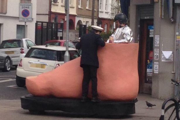 Man Driving Giant Foot Leaves London Very, Very
