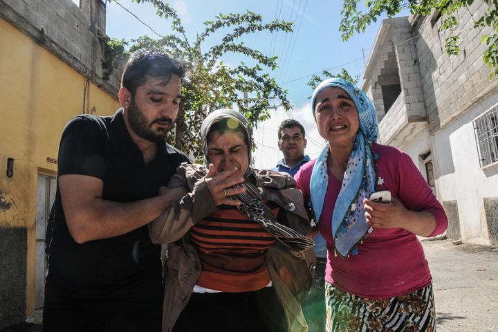 Residents flee as rockets fired from Islamic State-controlled Syria land in the Turkish border city of Kilis on Apr