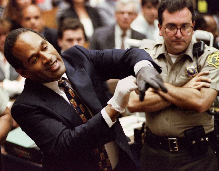 "O.J. Simpson tries on ""the gloves"" during his murder trial."