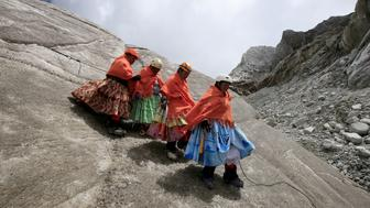 "Aymara indigenous women practise descending on a glacier at the Huayna Potosi mountain, Bolivia April 6, 2016. Two years ago, about a dozen Aymara indigenous women, aged 42 to 50, who worked as porters and cooks for mountaineers at base camps and mountain climbing refuges on the steep, glacial slopes of Huayna Potosi, an Andean peak outside La Paz, Bolivia, put on crampons under their wide traditional skirts and started to do their own climbing. REUTERS/David Mercado   SEARCH ""CHOLITA CLIMBERS"" FOR THIS STORY. SEARCH ""THE WIDER IMAGE"" FOR ALL STORIES"