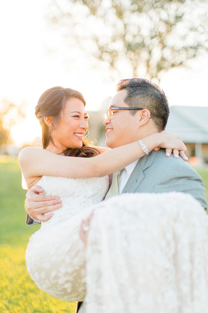 "Want light and airy wedding portraits like the one above? Be sure to schedule your ceremony accordingly, photographer Michelle Able recommends. A sunset ceremony seems romantic, but means it could be dark by the time you finish saying your ""I dos."""