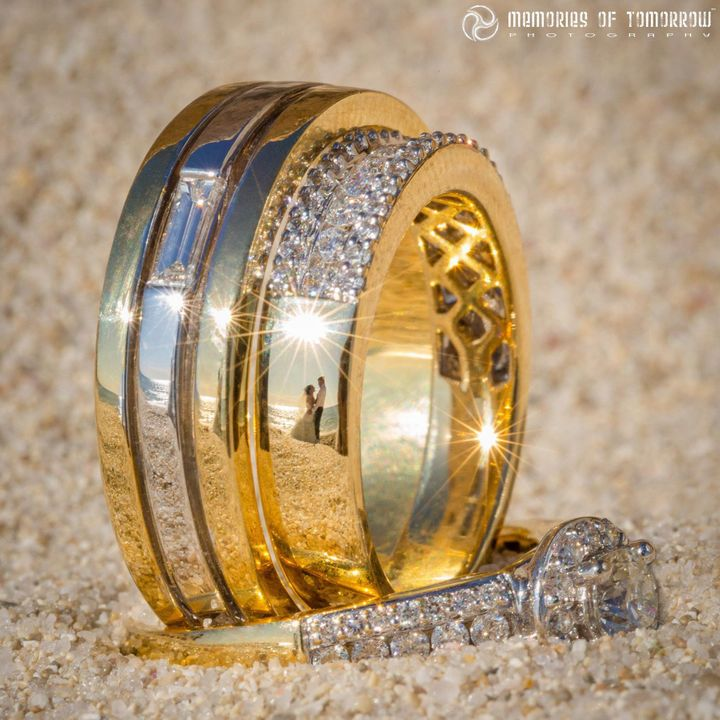 "Adams-Shawn started taking ""ringscape"" photos by chance in 2012, when he noticed a reflection of the bride and groom in the pair's rings."