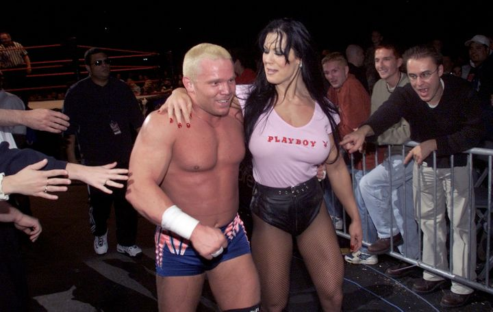 Chyna walks off with Crash duringa pro wrestling eventat Air Canada Centre, Toronto, in October 2000.