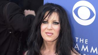 385801 36: WWF wrestler Chyna arrives at the 43rd Annual Grammy Awards held at Staples Center February 21, 2001 in Los Angeles, CA. (Photo by Laura Farr/Newsmakers)