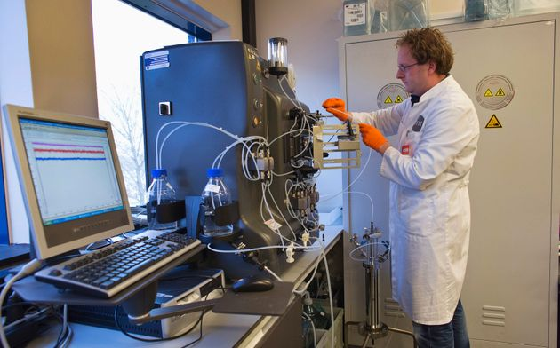 An operator installs a chromatography column to purify the gene therapy drug Glybera at Dutch biotech...