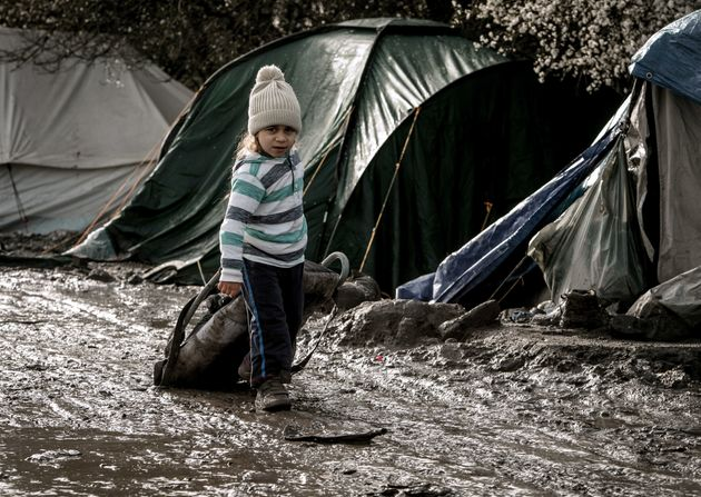 A child walks in the Jungle refugee camp in Grande Synthe, near Dunkirk,