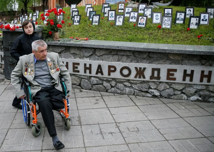 A rescue worker who served during the Chernobyl nuclear disaster attends a commemoration ceremony in Kiev. Over half a m