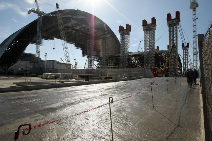 A steel-clad arch, costing 1.5 billion euros, has just been completed. It was designed to enclose the stricken