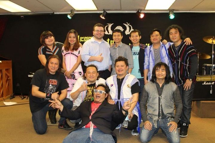 The Klo & Kweh Music Team pose with band manager Eh Wah (center) and Institute for Justice attorney Dan Alban (center, wi