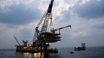 An offshore platform of Aramco's Karan non-associated gas field is seen in Saudi Arabia's territorial waters in this undated handout picture. Saudi Arabia could as early as 2013 do something it has resisted for decades: raise what is currently the world's lowest price for natural gas, in order to reduce expensive subsidies and curb energy waste. A price hike would be an important economic shift for the country but a difficult one, as it would risk hurting the competitiveness of industries such as petrochemicals. To match Analysis SAUDI-GAS/PRICE  REUTERS/Saudi Aramco/Handout (SAUDI ARABIA - Tags: ENERGY BUSINESS) FOR EDITORIAL USE ONLY. NOT FOR SALE FOR MARKETING OR ADVERTISING CAMPAIGNS. THIS IMAGE HAS BEEN SUPPLIED BY A THIRD PARTY. IT IS DISTRIBUTED, EXACTLY AS RECEIVED BY REUTERS, AS A SERVICE TO CLIENTS