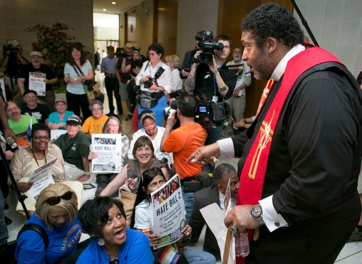 North Carolina NAACP President Rev. William Barber leads a peaceful sit-in protest in opposition to HB2 at the State Legislat