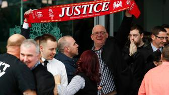 Relatives hold up a scarf after the jury delivered its verdict at the new inquests into the Hillsborough disaster, in Warrington, Britain April 26, 2016.      REUTERS/Phil Noble
