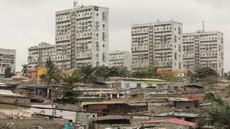 High-rise buildings are seen behind informal settlements in the capital of Luanda, in this August 30, 2012 file photo. REUTERS/Siphiwe Sibeko/Files