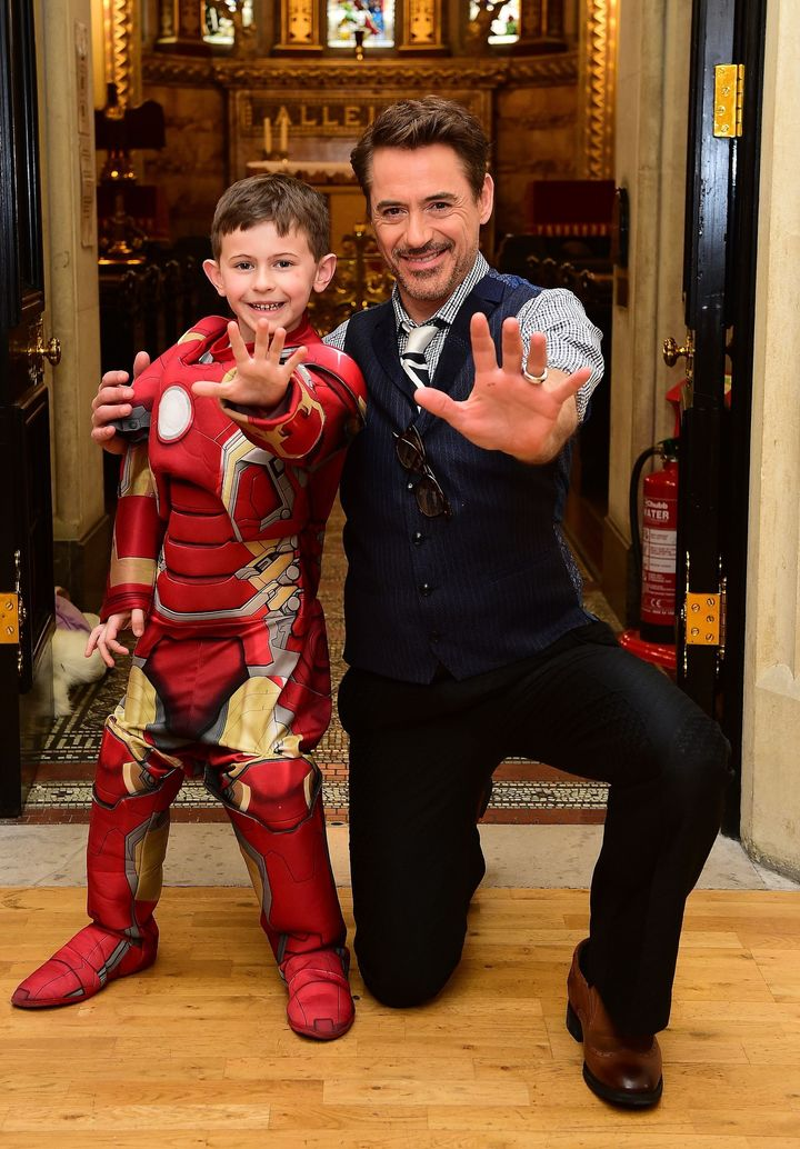 """Iron Man"" actor Robert Downey Jr. meets 7-year-old Ethan Miller, from Southend, Essex, who suffers from the rare blood disea"