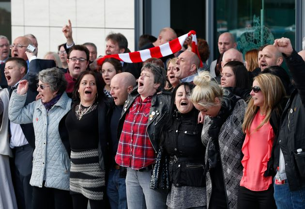 Relatives of those who died in the Hillsborough disaster sing You'll Never Walk Alone outside the the