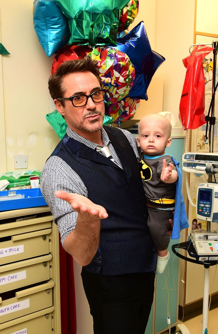 Robert Downey Jr. holds Charlie Dawson, 1, from Southend-on-Sea, Essex.