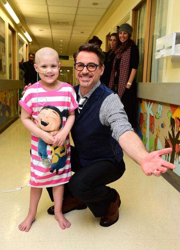 Robert Downey Jr. with Chloe Bowers, aged 5 from Ruislip, West London.