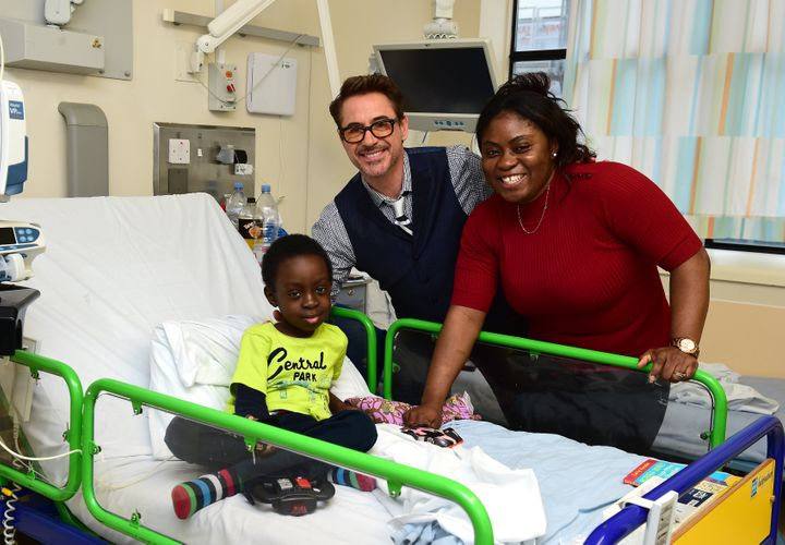 Robert Downey Jr. (centre) meets Michael, aged 7 from Edmonton, during a visit to Great Ormond Street Hospital (GOSH), in Lon