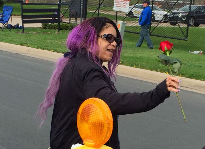 Tyka Nelson holds a rose outside Paisley Park, the home of her brother Prince in Chanhassen, Minn., on Thursday, April 21, 20