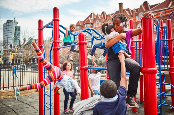 """Kenya and friends play on the jungle gym during recess. When a young person loses a family member to a shooting, it """"me"""