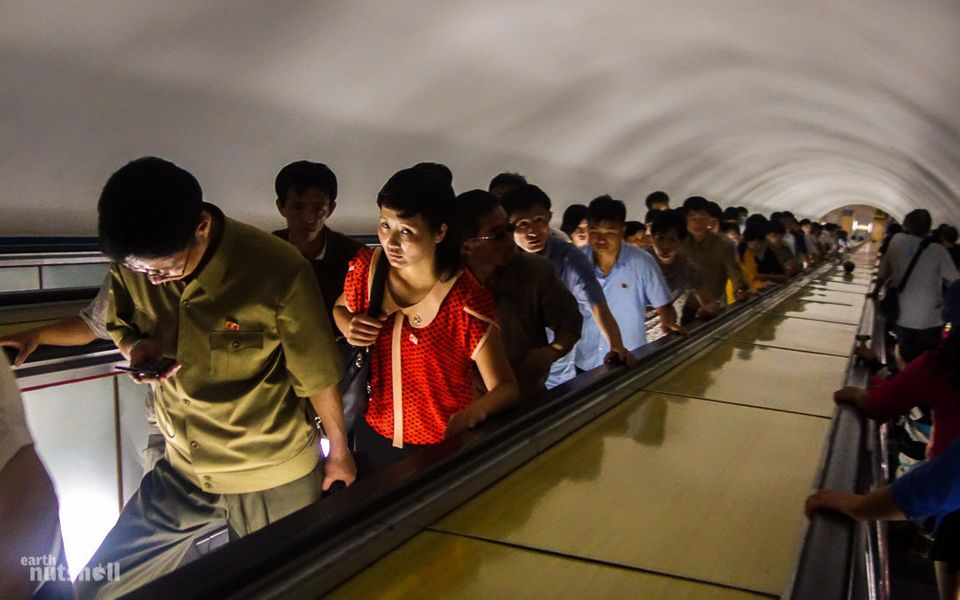 "Commuters ride an escalator at a metro stop. Because the system is built so deep under the city, ""It's an almost f"
