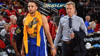 HOUSTON, TX - APRIL 24:  Stephen Curry #30 and Steve Kerr of the Golden State Warriors talk after warming up during halftime of Game Four of the Western Conference Quarterfinals against the Houston Rockets during the 2016 NBA Playoffs on April 24, 2016 at the Toyota Center in Houston, Texas. NOTE TO USER: User expressly acknowledges and agrees that, by downloading and or using this photograph, User is consenting to the terms and conditions of the Getty Images License Agreement. Mandatory Copyright Notice: Copyright 2016 NBAE (Photo by Bill Baptist/NBAE via Getty Images)