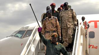 General Simon Gatwech Dual, the chief of staff of the rebel troops of the Sudan People's Liberation Army in Opposition (SPLA-IO), waves to supporters as he arrives at the Juba International Airport in South Sudan's capital Juba, April 25, 2016. REUTERS/Jok Solomun EDITORIAL USE ONLY. NO RESALES. NO ARCHIVE      TPX IMAGES OF THE DAY