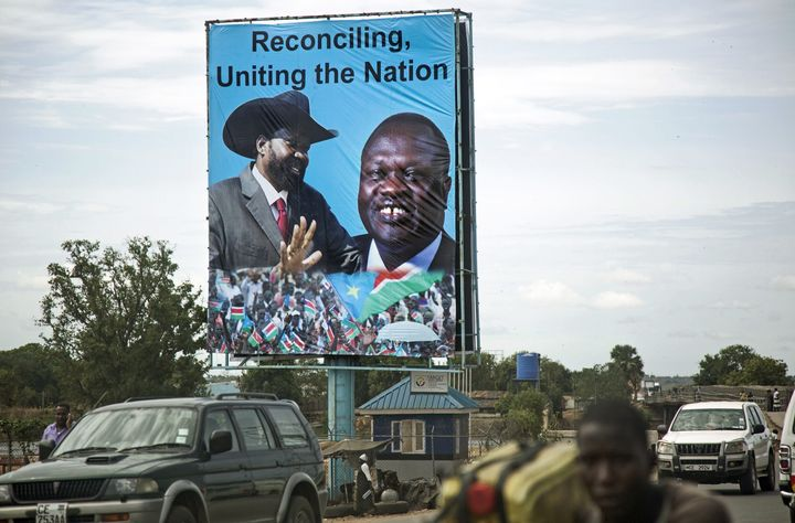 Above, abillboard ofPresident Salva Kiir and opposition leader Riek Machar in Juba earlier this month. Machar's r