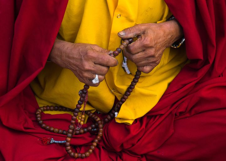 A Buddhist monk with his prayer chain.