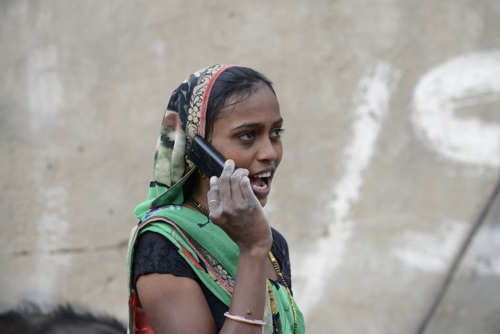 An Indian woman speaks on a mobile phone in Suraj village in Mehsana district, some 100 km from Ahmedabad, on February 20, 20