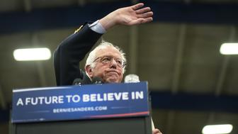 Senator Bernie Sanders, an independent from Vermont and 2016 Democratic presidential candidate, waves during a campaign event in Pittsburgh, Pennsylvania, U.S., on Monday, April 25, 2016. Sanders said he's lost Democratic presidential nominating contests to Hillary Clinton in states with high levels of income inequality, an issue he's centered his campaign on, because not enough low-income people go to the polls. Photographer: Pete Marovich/Bloomberg via Getty Images