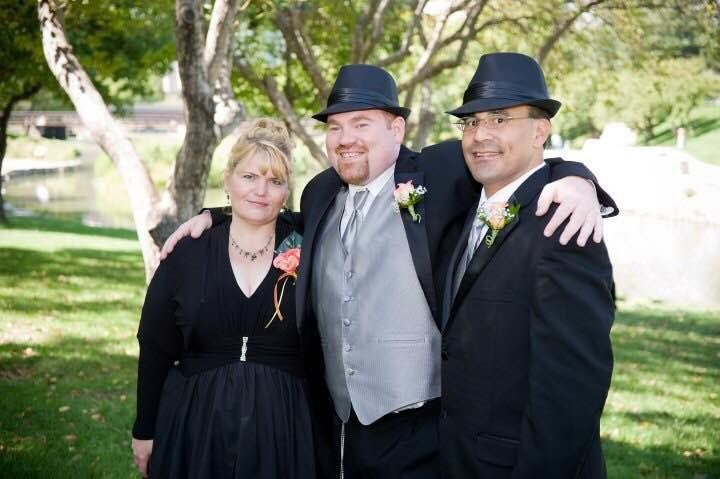 Andrew, center, with his ex-mother-in-law Sibrina, and ex-father-in-law Tom.